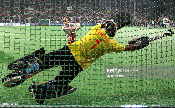 Glenn Kirkham of England has his penalty saved by Bharat Kumar Chetri of India in the penalty shoot out during the semi final hockey match between...