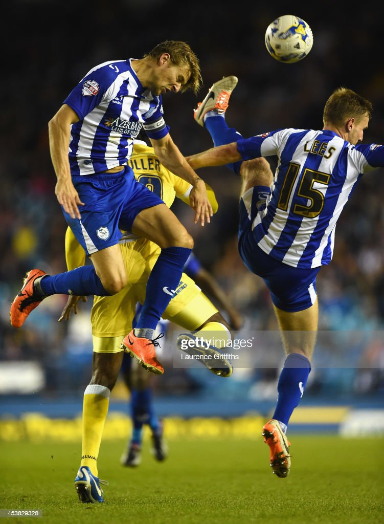 Glenn Loovens and Tom Lees of Sheffield Wednesday rise for the ball with Ricardo Fuller of Millwall during the Sky Bet Championship match between Sheffield Wednesday and Millwall at Hillsborough Stadium on August 19, 2014 in Sheffield, England.