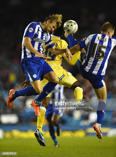 Glenn Loovens and Tom Lees of Sheffield Wednesday rise for the ball with Ricardo Fuller of Millwall during the Sky Bet Championship match between...