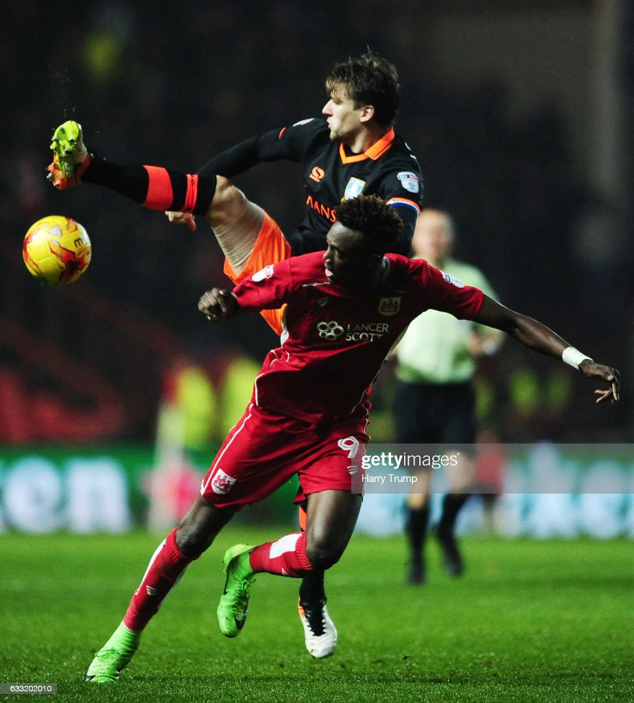 Glenn Loovens of Sheffield Wednesday is tackled by Tammy Abraham of Bristol City during the Sky Bet Championship match between Bristol City and Sheffield Wednesday at Ashton Gate on January 31, 2017 in Bristol, England.