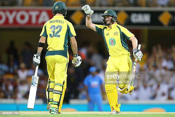 Glenn Maxwell and George Bailey of Australia celebrate winning game two of the Victoria Bitter One Day International Series between Australia and...