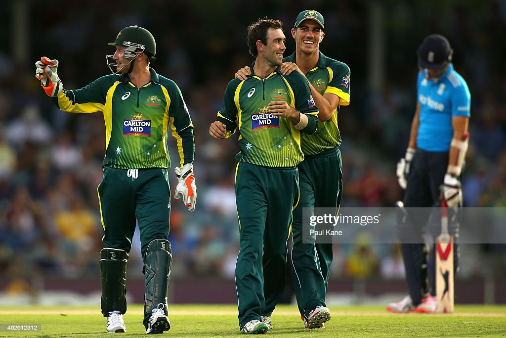 Glenn Maxwell and Pat Cummins of Australia celebrate after the wicket of Stuart Broad of England during the final match of the Carlton Mid One Day...