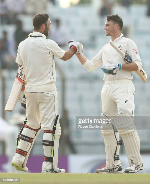 Glenn Maxwell and Peter Handscomb of Australia celebrate after Australia defeated Bangladesh during day four of the Second Test match between...