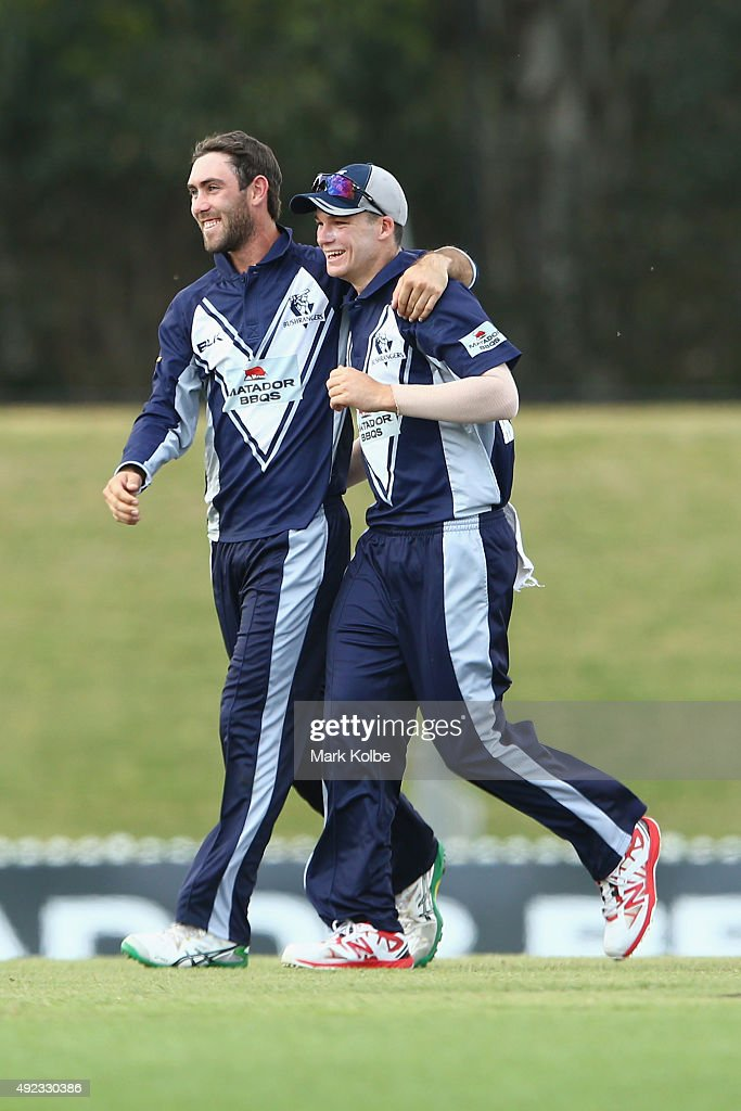 Glenn Maxwell and Peter Handscomb of the Bushrangers celebrate the wicket of Adam Voges of the Warriors during the Matador BBQs One Day Cup match...