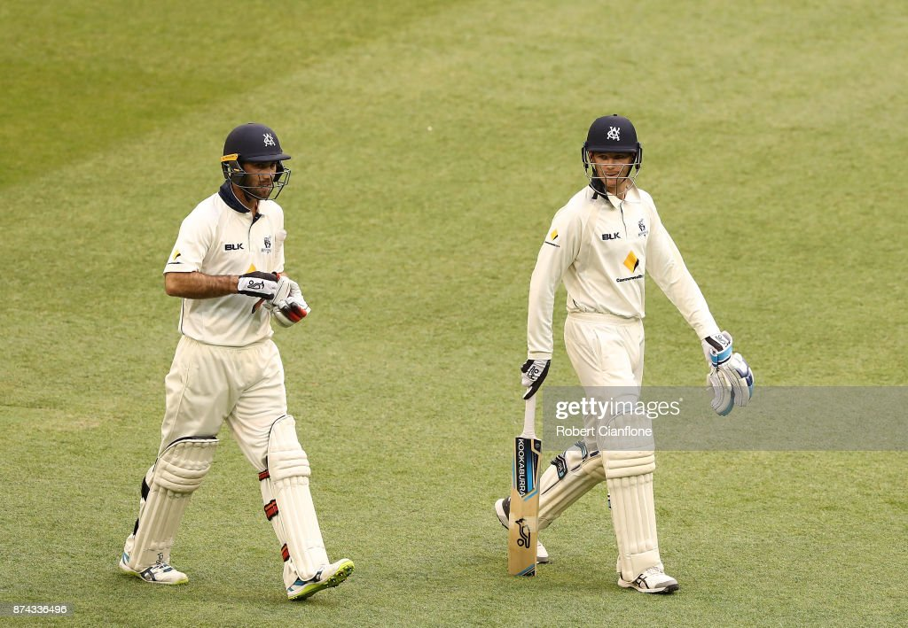 Glenn Maxwell and Peter Handscomb of Victoria walk off the ground as rain stops play during day three of the Sheffield Shield match between Victoria and Tasmania at Melbourne Cricket Ground on November 15, 2017 in Melbourne, Australia.