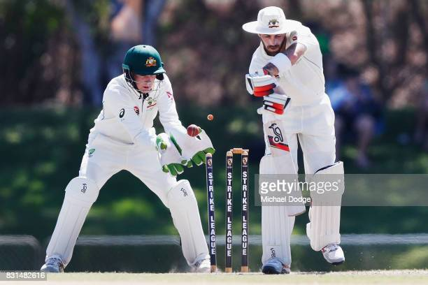 Glenn Maxwell is bowled by Nathan Lyon during day two of the Australian Test cricket intersquad match at Marrara Cricket Ground on August 15 2017 in...