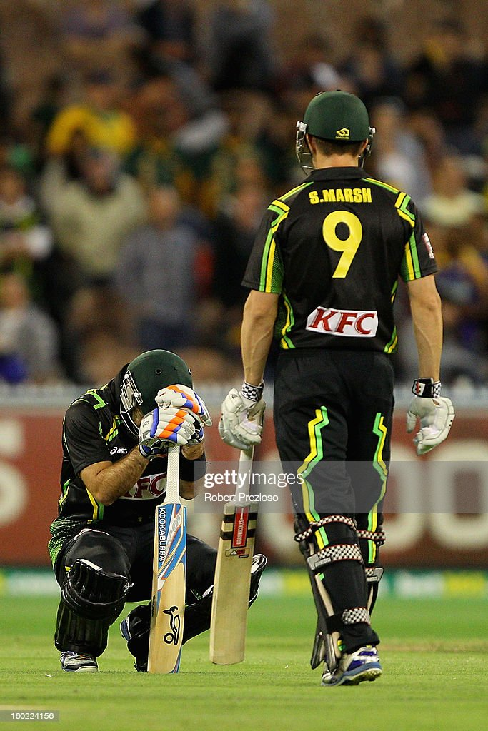 <a gi-track='captionPersonalityLinkClicked' href=/galleries/search?phrase=Glenn+Maxwell&family=editorial&specificpeople=752174 ng-click='$event.stopPropagation()'>Glenn Maxwell</a> of Australia and <a gi-track='captionPersonalityLinkClicked' href=/galleries/search?phrase=Shaun+Marsh+-+Cricket+Player&family=editorial&specificpeople=236104 ng-click='$event.stopPropagation()'>Shaun Marsh</a> of Australia show their dejection after a loss to Sri Lanka during game two of the Twenty20 International series between Australia and Sri Lanka at Melbourne Cricket Ground on January 28, 2013 in Melbourne, Australia.