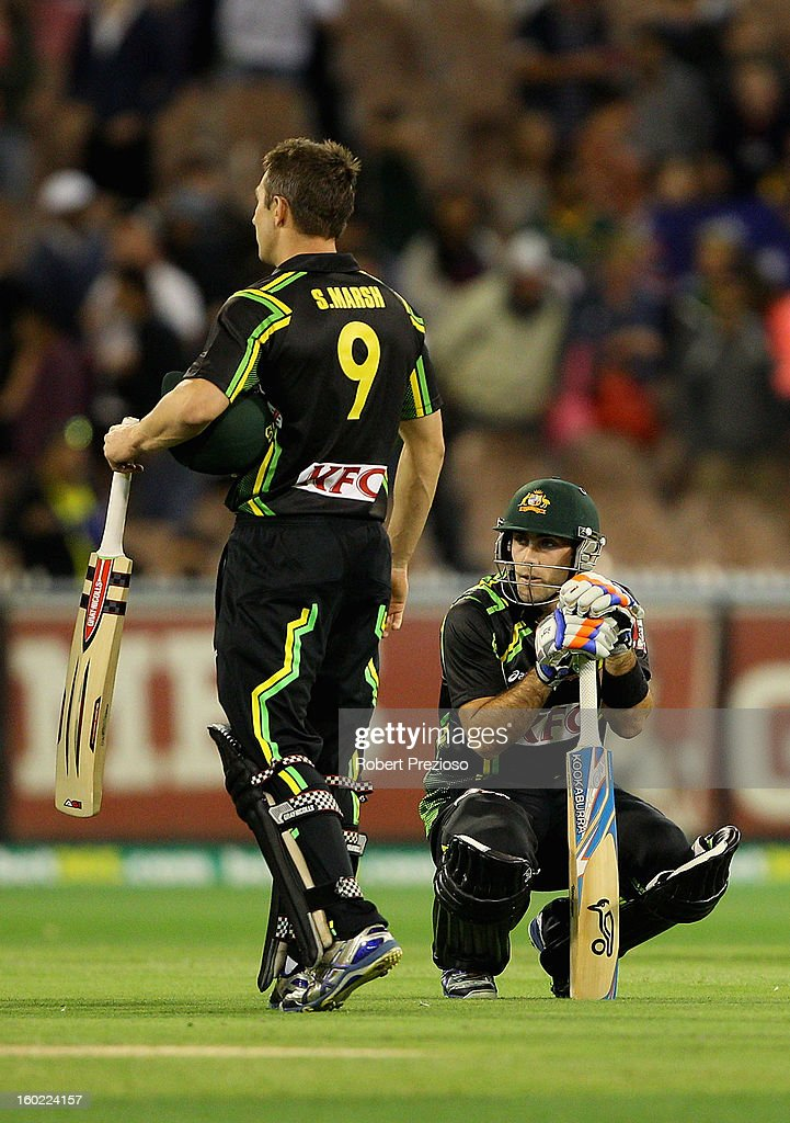 Glenn Maxwell of Australia and Shaun Marsh of Australia show their dejection after a loss to Sri Lanka during game two of the Twenty20 International series between Australia and Sri Lanka at Melbourne Cricket Ground on January 28, 2013 in Melbourne, Australia.