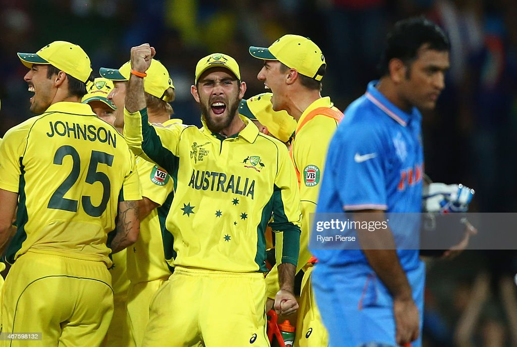 Glenn Maxwell of Australia celebrates after Mitchell Starc of Australia took the wicket of Ajinkya Rahane of India during the 2015 Cricket World Cup...