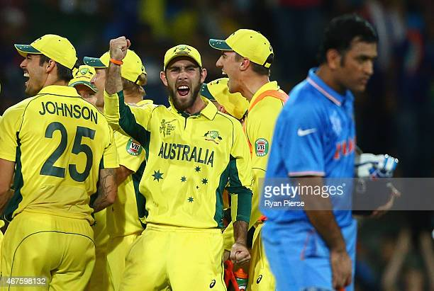 Glenn Maxwell of Australia celebrates after Mitchell Starc of Australia took the wicket of Ajinkya Rahane of India during the 2015 Cricket World Cup...
