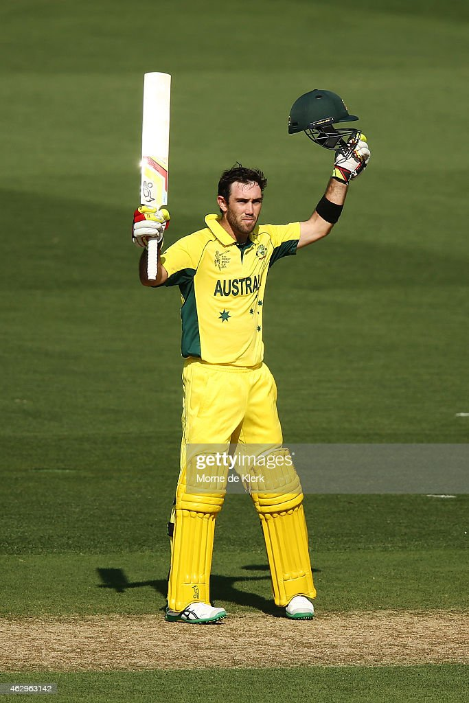 Glenn Maxwell of Australia celebrates after reaching 100 runs during the ICC Cricket World Cup warm up match between Australia and India at Adelaide...