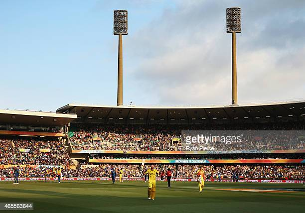 Glenn Maxwell of Australia celebrates as he walks from the ground after being dismissed for102 runs during the 2015 ICC Cricket World Cup match...