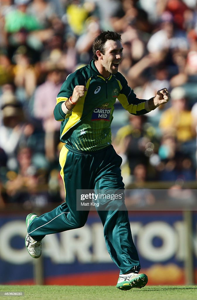 Glenn Maxwell of Australia celebrates taking the wicket of Jos Buttler of England during the final match of the Carlton Mid One Day International...