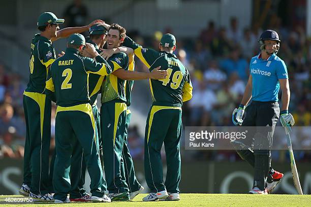Glenn Maxwell of Australia celebrates with team mates after dismissing Jos Buttler of England during the final match of the Carlton Mid One Day...