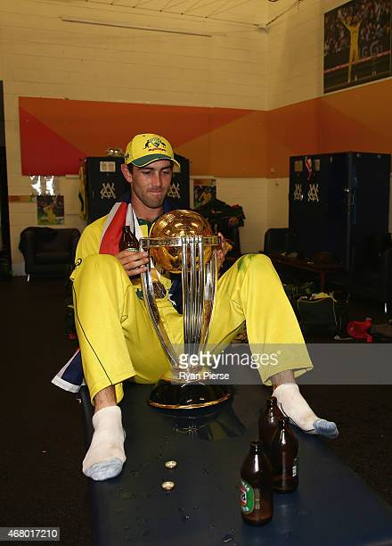 Glenn Maxwell of Australia celebrates with the trophy in the change rooms during the 2015 ICC Cricket World Cup final match between Australia and New...