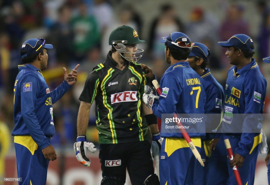 <a gi-track='captionPersonalityLinkClicked' href=/galleries/search?phrase=Glenn+Maxwell&family=editorial&specificpeople=752174 ng-click='$event.stopPropagation()'>Glenn Maxwell</a> of Australia has words with the Sri Lankan team after the final ball of the game during game two of the Twenty20 International series between Australia and Sri Lanka at the Melbourne Cricket Ground on January 28, 2013 in Melbourne, Australia.