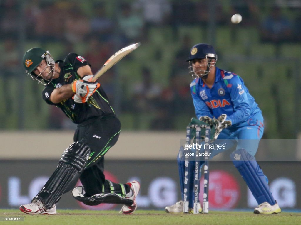 <a gi-track='captionPersonalityLinkClicked' href=/galleries/search?phrase=Glenn+Maxwell&family=editorial&specificpeople=752174 ng-click='$event.stopPropagation()'>Glenn Maxwell</a> of Australia hits a six as MS Dhoni of India looks on during the ICC World Twenty20 Bangladesh 2014 match between India v Australia at Sher-e-Bangla Mirpur Stadium on March 30, 2014 in Dhaka, Bangladesh.