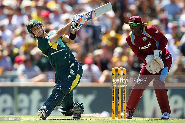 Glenn Maxwell of Australia hits out during game one of the Commonwealth Bank One Day International Series between Australia and the West Indies at...