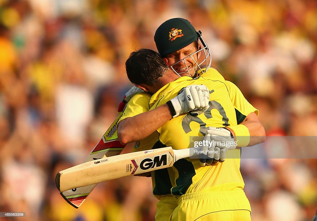 Glenn Maxwell of Australia is congratulated by Shane Watson of Australia after reaaching his century during the 2015 ICC Cricket World Cup match...
