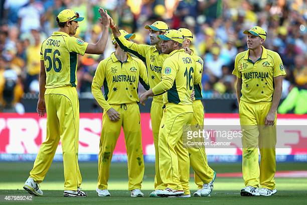Glenn Maxwell of Australia is congratulated by team mates after running out Tim Southee of New Zealand during the 2015 ICC Cricket World Cup final...
