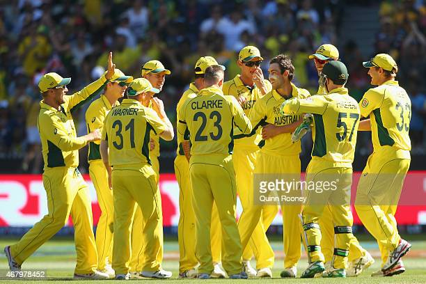 Glenn Maxwell of Australia is congratulated by team mates after getting the wicket of Martin Guptill of New Zealand during the 2015 ICC Cricket World...
