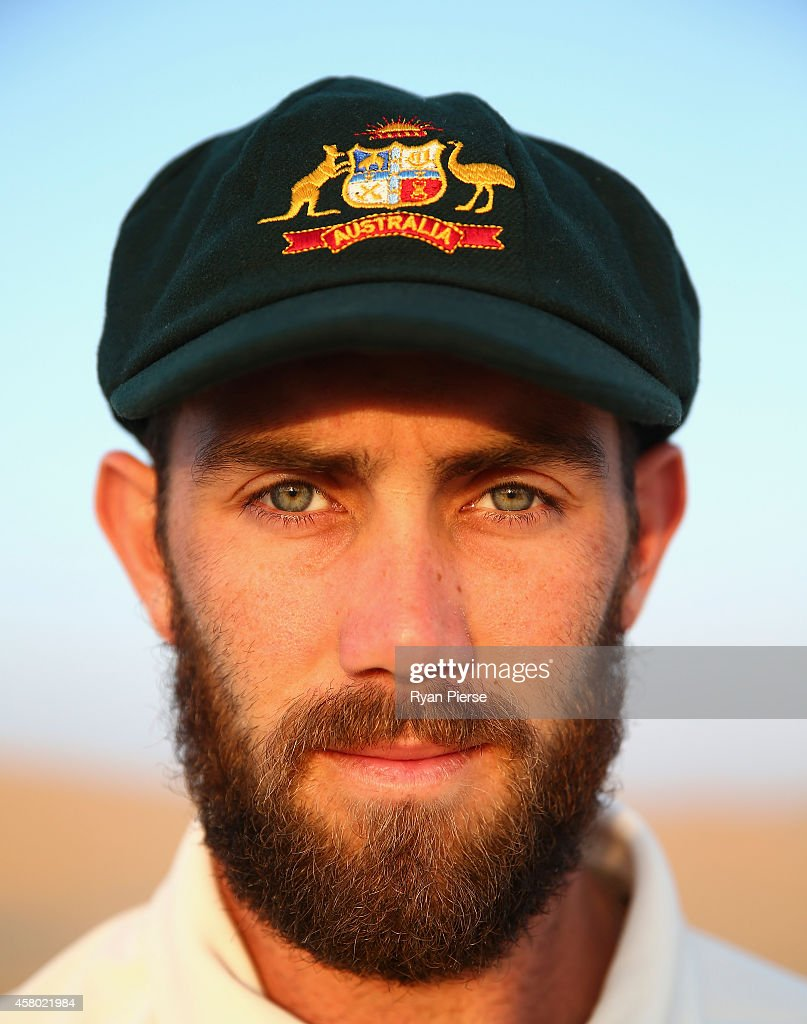 <a gi-track='captionPersonalityLinkClicked' href=/galleries/search?phrase=Glenn+Maxwell&family=editorial&specificpeople=752174 ng-click='$event.stopPropagation()'>Glenn Maxwell</a> of Australia poses as the sun rises over Al Khatim Sand Dunes on October 29, 2014 in Abu Dhabi, United Arab Emirates.
