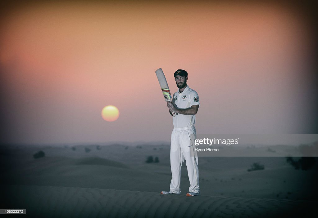 Glenn Maxwell of Australia poses as the sun rises over Al Khatim Sand Dunes on October 29 2014 in Abu Dhabi United Arab Emirates