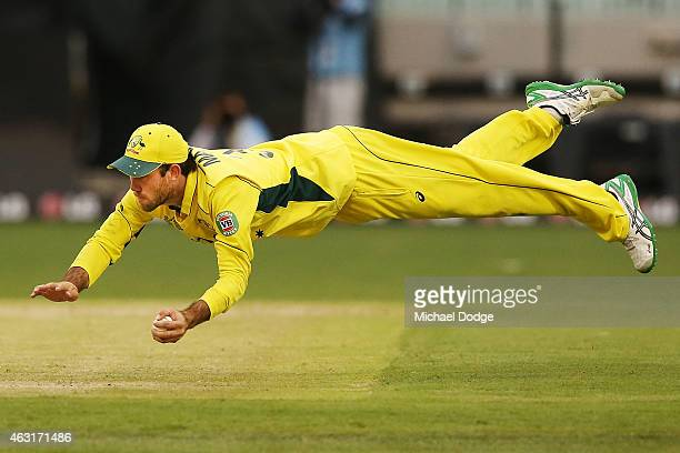 Glenn Maxwell of Australia takes a diving catch to dismiss Shaiman Anwar of UAE during the Cricket World Cup warm up match between Australia and the...