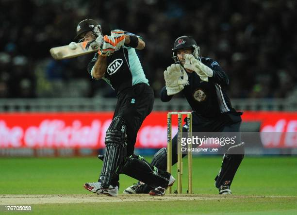Glenn Maxwell of Surrey in action as wicketkeeper David Murphy of Northants tries to stop it during the Friends Life T20 Final match between Surrey...