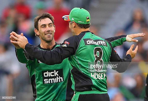 Glenn Maxwell of the Stars is congratulated by David Hussey after taking the wicket of Shane Watson of the Thunder during the Big Bash League match...