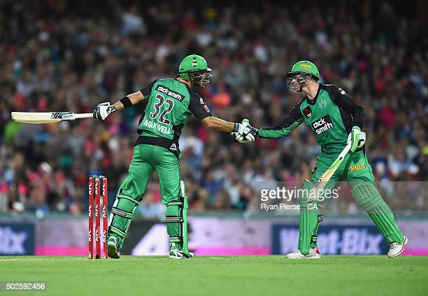 Glenn Maxwell of the Stars is congratulated by Peter Handscomb of the Stars after he reached his half century during the Big Bash League match...
