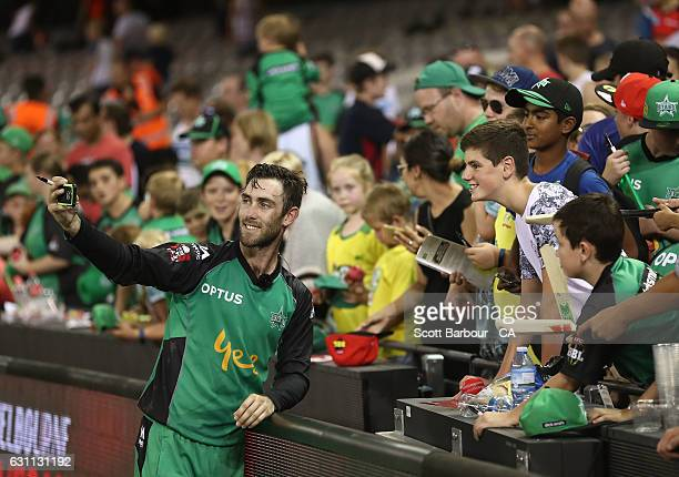 Glenn Maxwell of the Stars signs autographs for supporters in the crowd during the Big Bash League match between the Melbourne Renegades and the...