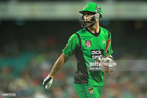 Glenn Maxwell of the Stars walks off the field after being dismissed by Josh Hazlewood of the Sixers during the Big Bash League match between the...