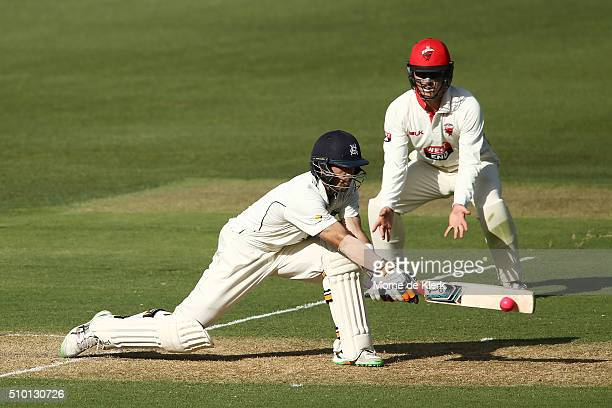 Glenn Maxwell of the VIC Bushrangers plays a reverse sweep to reach 50 runs during day one of the Sheffield Shield match between South Australia and...