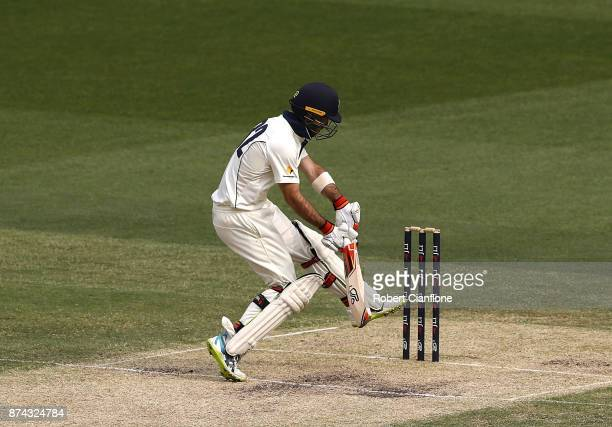 Glenn Maxwell of Vicitoria avoids a rising delivery from Riley Meredith of Tasmania during day three of the Sheffield Shield match between Victoria...