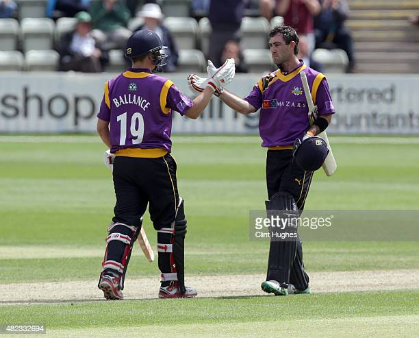 Glenn Maxwell of Yorkshire celebrates with teammate Gary Ballance after he reaches his century during the Royal London OneDay Cup match between...