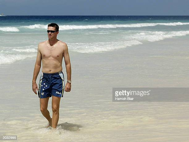 Glenn McGrath of Australia walks on the beach on April 25 2003 in Bridgetown Barbados