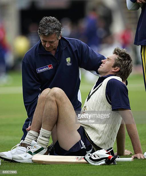 Glenn McGrath of Australia winces in pain as physio Errol Alcott attends to an injury before day one of the Second Test between England and Australia...