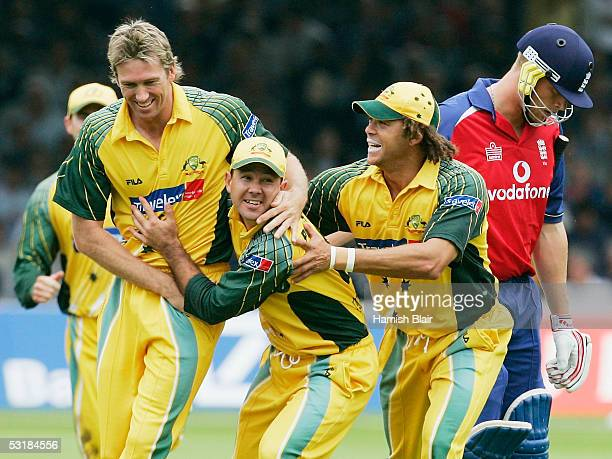 Glenn McGrath Ricky Ponting and Andrew Symonds of Australia celebrate the wicket of Andrew Flintoff of England during the NatWest Series Final...
