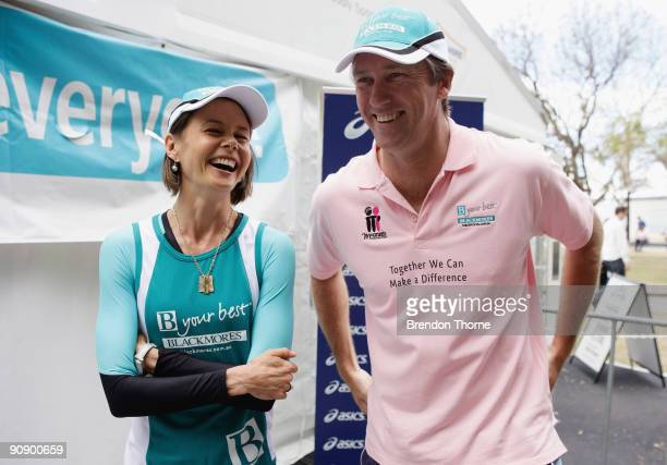 Glenn McGrath shares a joke with Antonia Kidman during a photo call ahead of Sunday's Blackmores Sydney Running Festival welcoming the official race...