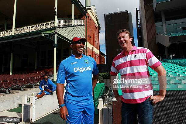 Glenn McGrath speaks with Phil Simmons West Indies cricket coach during a photo call at Sydney Cricket Ground on January 1 2016 in Sydney Australia