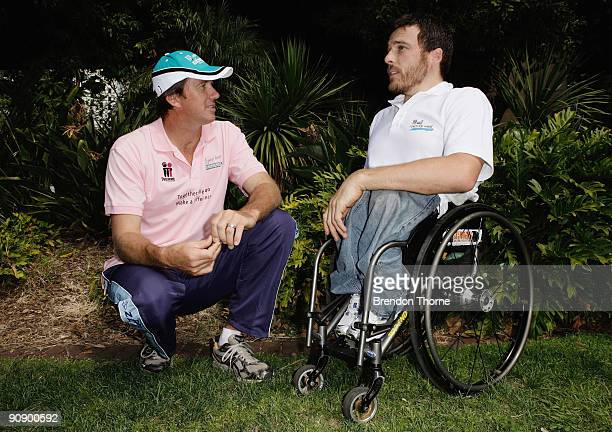 Glenn McGrath talks race tactics with Kurt Fearnley during a photo call ahead of Sunday's Blackmores Sydney Running Festival welcoming the official...