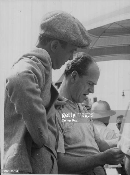 Glenn Miller Story Jimmy Stewart who plays the lead role in 'The Glenn Miller Story' goes over the script with director Anthony Mann before actual...