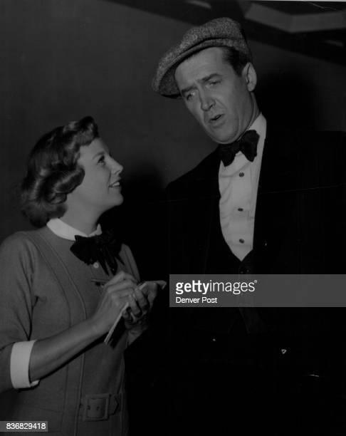 Glenn Miller Story June Allyson adopts a newshunting pose as she interviews Jimmy Stewart her costar in 'The Glenn Miller Story' The film stars have...