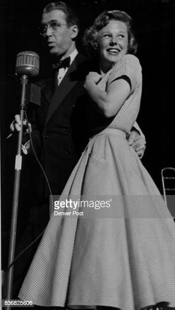 Glenn Miller Story Pert June Allyson smiles prettily as she poses with costar Jimmy Stewart during a lull in the moviemaking She wasn't in Friday's...