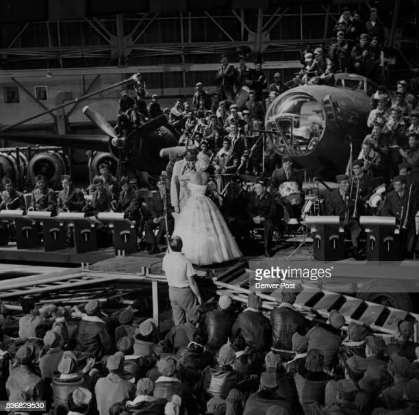 Glenn Miller Story The men in uniform cheer lustily as Miss Langford kisses bashful gangling Jimmy Stewart on the cheek during a scene rehearsal In...