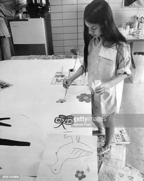 Glenn Montgomery Joanna Ong Carl Sandburg Elementary School Sixth graders repair original drawing onto billboard panels which will be used to...