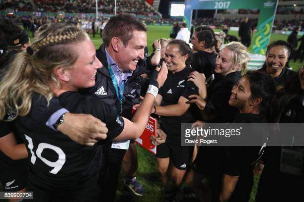 Glenn Moore the New Zealand Black Ferns head coach celebrates with his team after their victory during the Women's Rugby World Cup 2017 Final betwen...