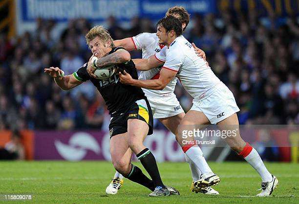 Glenn Morrison of Exiles is tackled by Jon Wilkin of England during the International Origin match between England and Exiles at Headingley Carnegie...