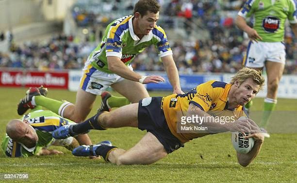 Glenn Morrison of the Eels scores during the round 19 NRL match between the Canberra Raiders and the Parramatta Eels held at Canberra stadium on July...